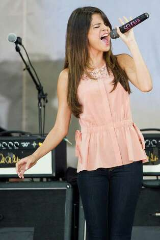 Selena Gomez performs on ABC's Good Morning America in New York, Friday, June 17, 2011. (AP Photo/Charles Sykes) Photo: Charles Sykes