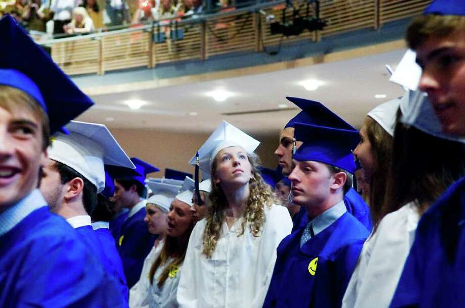 Katherine Matson looks around the auditorium as the graduates process in for the Darien High School 2011 Commencement Exercises in Darien, Conn. on Friday June 17, 2011. Photo: Kathleen O'Rourke / Stamford Advocate
