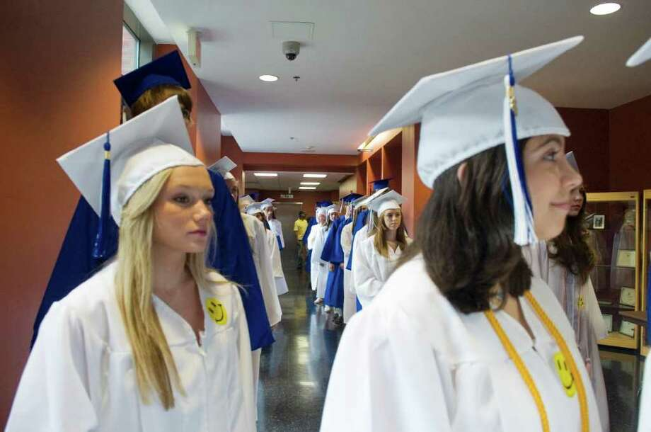 The Darien High School Class of 2011 process into the auditorium for the Commencement Exercises in Darien, Conn. on Friday June 17, 2011. Photo: Kathleen O'Rourke / Stamford Advocate