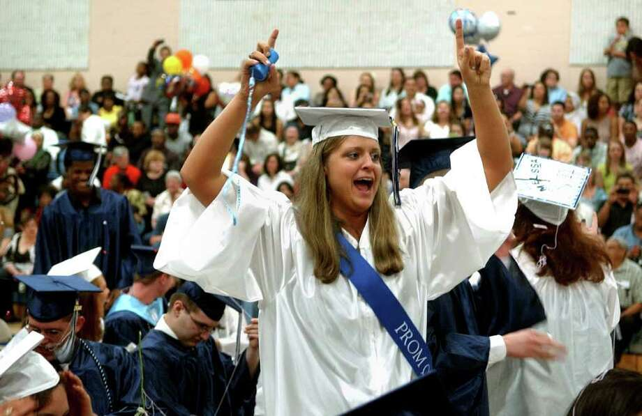 Graduate Alyssa Goggi cheers after the final classmate received his diploma, during Ansonia High's Commencement Exercises in Ansonia, Conn. on Thursday June 17, 2011. Photo: Christian Abraham / Connecticut Post