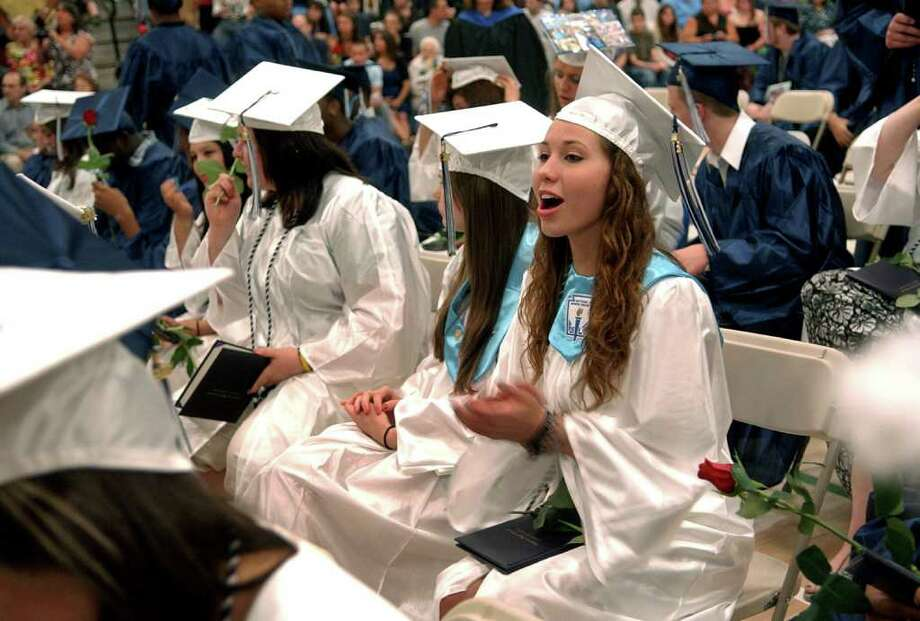 Highlights from Ansonia High School's Commencement Exercises in Ansonia, Conn. on Thursday June 17, 2011. Graduate Jennie Rose Ellis claps and cheers as her fellow students receive diplomas. Photo: Christian Abraham / Connecticut Post