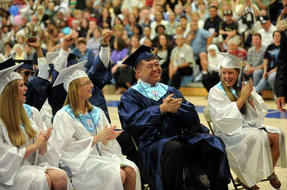 Highlights from Ansonia High School's Commencement Exercises in Ansonia, Conn. on Thursday June 17, 2011. Graduate Wilson Min Fong, center, sits with fellow classmates. Photo: Christian Abraham / Connecticut Post
