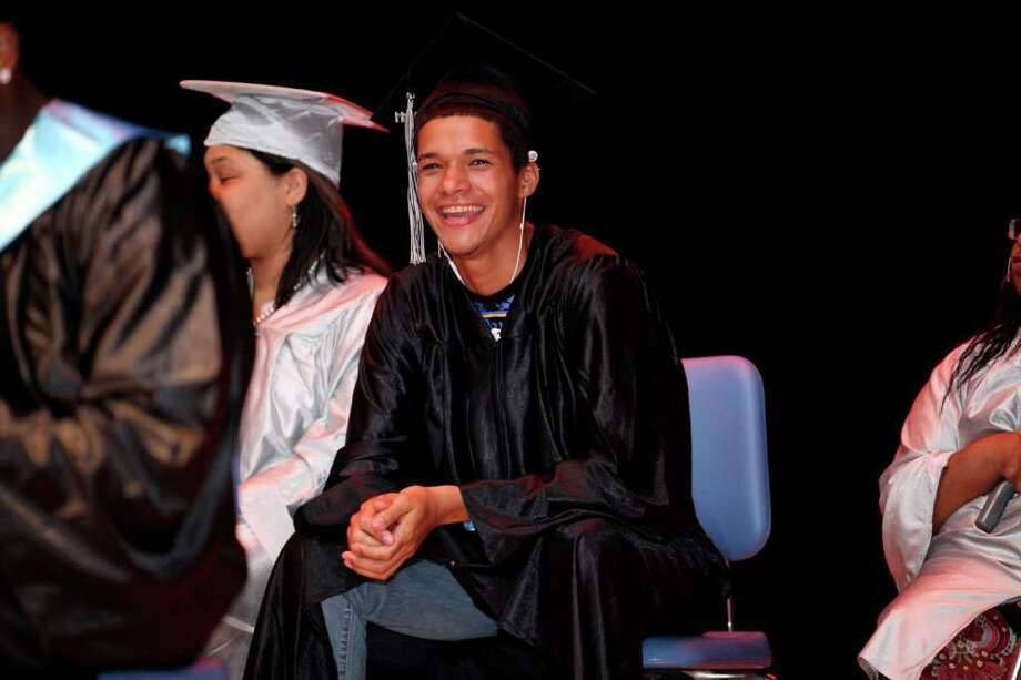 Joshua Vazquez, a graduate of Bridge Academy laughs during the salutatory address at Thurgood Marshall middle School in Bridgeport, CT on Friday, June 17, 2011. Photo: Francesca Andre / Connecticut Post