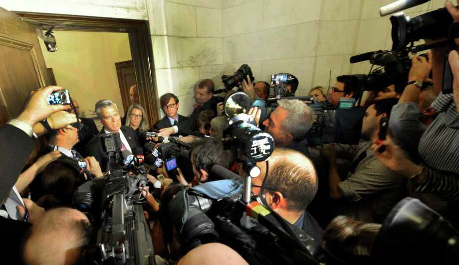 Senate Majority Leader Dean Skelos meets the media in the doorway of his office complex in the State Capitol in Albany, N.Y. June 17, 2011, to give a briefing on what the Republican caucus doing behind closed doors. (Skip Dickstein / Times Union) Photo: SKIP DICKSTEIN / 2011