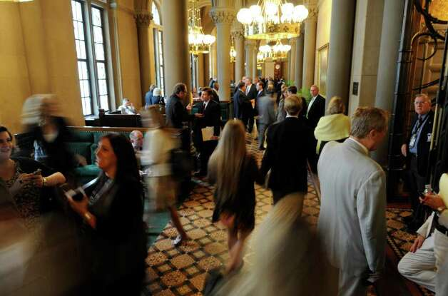 The hallways outside of the Senate Chamber are a beehive of activity in the last hours of the session in the State Capitol in Albany, N.Y. June 17, 2011, (Skip Dickstein / Times Union) Photo: SKIP DICKSTEIN / 2011