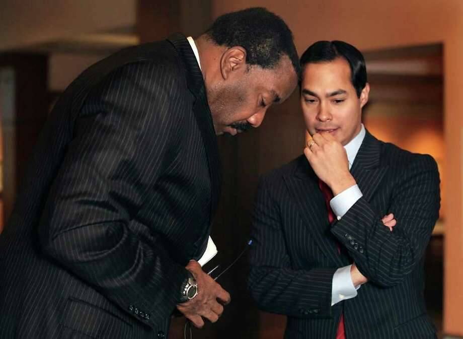 CPS Energy President and CEO Doyle Beneby, left, shared a private word with San Antonio Mayor Julian Castro before the CPS Energy's presentation of 2011 Plans for the Future at the Witte Museum. One of our readers takes Deneby to task for approving the recent bonuses for CPS executives. Photo: BOB OWEN, Bob Owen / Rowen@express-news.net / SAN ANTONIO EXPRESS-NEWS