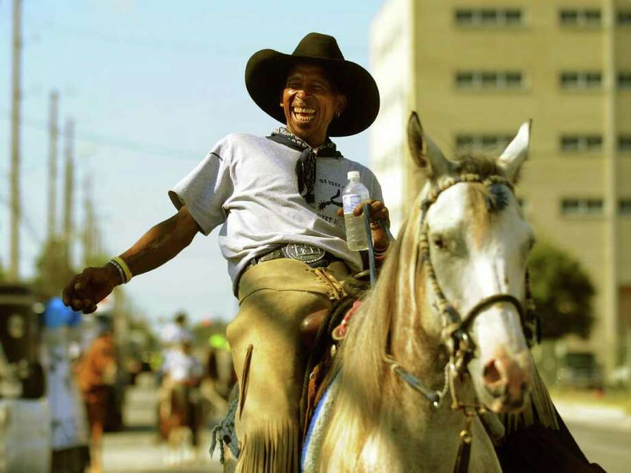 """""""Cowboy"""" Jones of the Silver Spurs riding group smiles during the annual San Antonio Juneteenth parade on Saturday, June 18, 2011. Juneteenth is the yearly celebration in remembrance of June 19, 1865, the day that the news of the abolition of slavery reached Texas at the end of the Civil War. Photo: BILLY CALZADA, BILLY CALZADA / Gcalzada@express-news.net / gcalzada@express-news.net"""