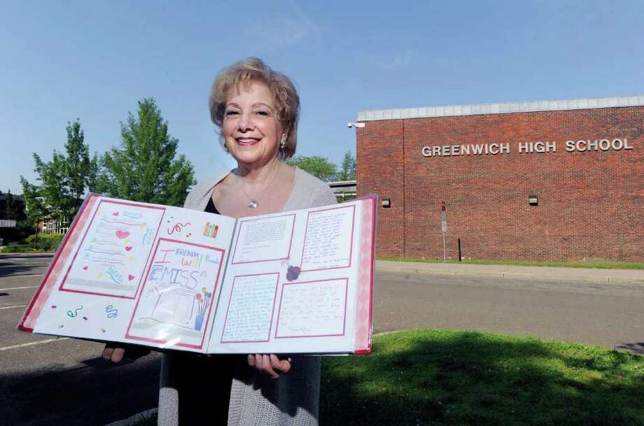 Brenda Friedler holds an album filled with cards from students, teachers and friends at Greenwich High School, Saturday morning, June 18, 2011.  Friedler, who is retiring, has had a 38-year tenure as a teacher and guidance counselor in the Greenwich public schools and will be the featured speaker at the Greenwich High School commencement Monday. Photo: Bob Luckey / Greenwich Time