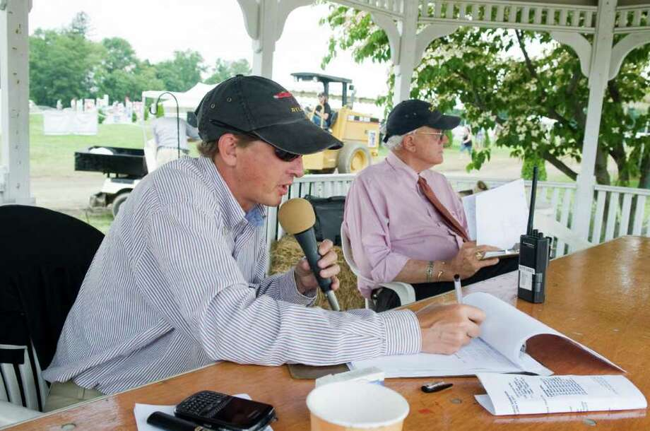 Jason Costick, an announcer from North Carolina, works alongside James Walter Lee, a judge for the Hunter 14 & Under class, at the 81st Annual Ox Ridge Charity Horse Show in Darien, Conn. on Saturday June 18, 2011. The event will benefit the Stamford Hospital. Photo: Kathleen O'Rourke / Stamford Advocate