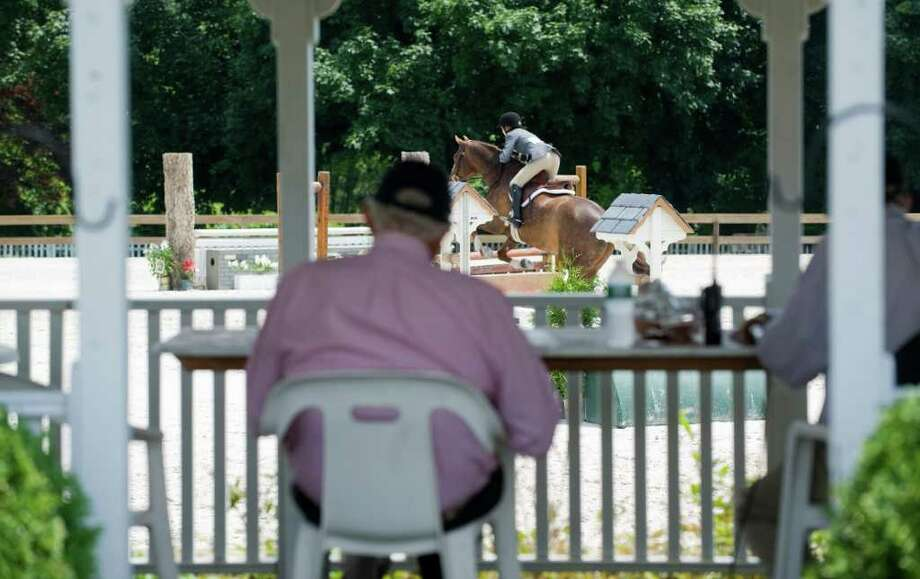 A judge watches a rider at the 81st Annual Ox Ridge Charity Horse Show in Darien, Conn. on Saturday June 18, 2011. The event will benefit the Stamford Hospital. Photo: Kathleen O'Rourke / Stamford Advocate