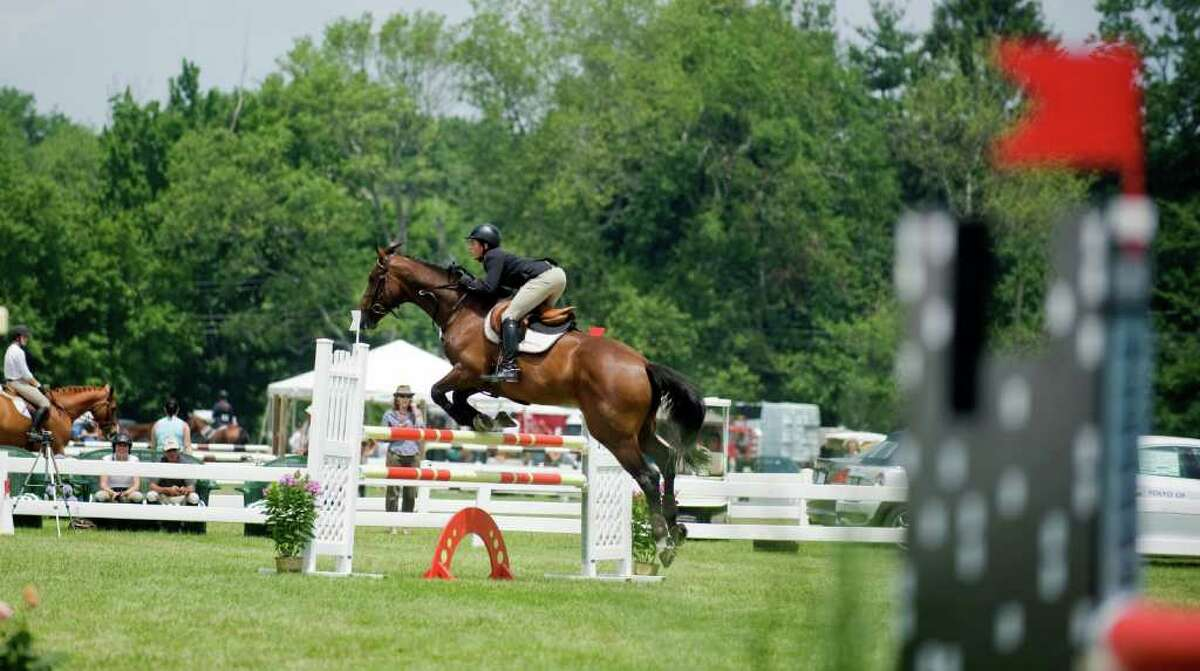 A rider competes at the 81st Annual Ox Ridge Charity Horse Show in Darien, Conn. on Saturday June 18, 2011. The event will benefit the Stamford Hospital.