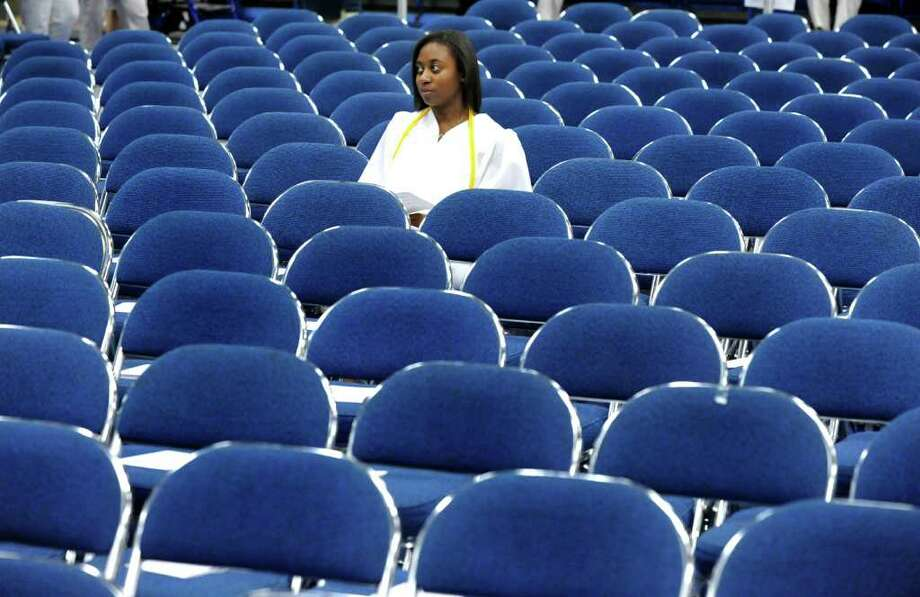 Nicole Theus waits for the start of Brookfield High School's graduation that was held at Western Connecticut State University's O'Neill Center in Danbury, Saturday, June 18, 2011. Photo: Michael Duffy / The News-Times
