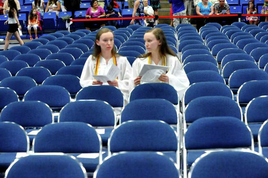 Michelle Esetrella, left, and Danielle Estrella, wait for the start of Brookfield High School's graduation that was held at Western Connecticut State University's O'Neill Center in Danbury, Saturday, June 18, 2011. Photo: Michael Duffy / The News-Times