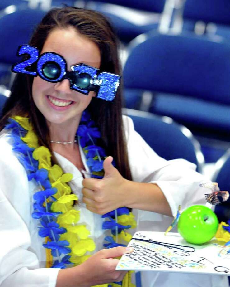 Aileen Tobin flashes a thumbs-up at the start of Brookfield High School's graduation that was held at Western Connecticut State University's O'Neill Center in Danbury, Saturday, June 18, 2011. Photo: Michael Duffy / The News-Times