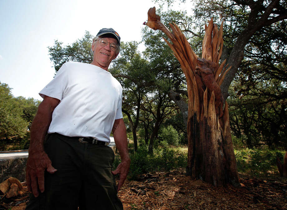 "Artist Larry Lefner stands near ""Birds Up,"" which he carved from a live oak tree that had been struck by lightning on the Joshua Creek Ranch. KIN MAN HUI / EXPRESS-NEWS"