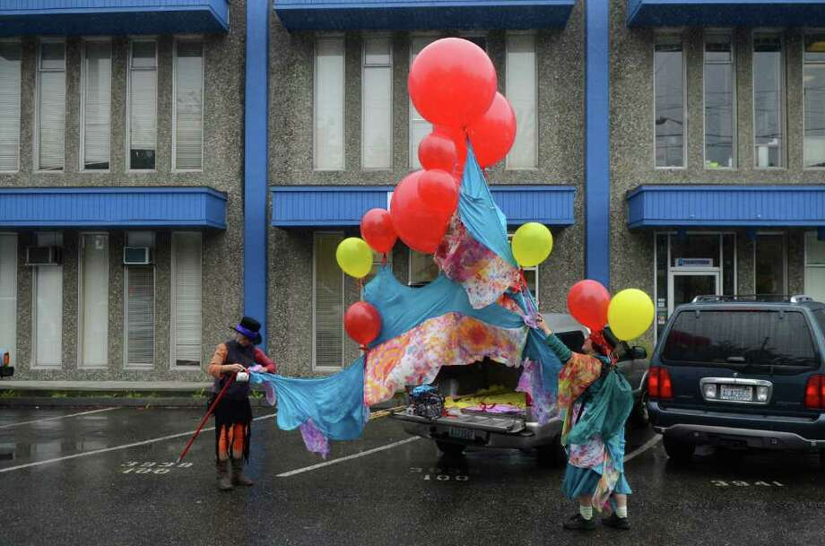 Gretchen Lawlor, left, and Sonia Telesco prepare their balloon display before the start of the Fremont Solstice Parade on Saturday, June 18, 2011 in Seattle. Lawlor, the treasurer of the Fremont Arts Council, said she has been attending the parade for 14 years. Photo: DANIEL BERMAN / SEATTLEPI.COM