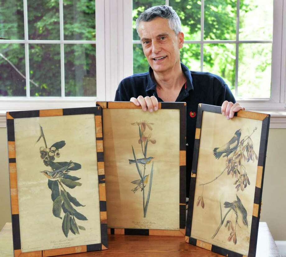 Dan Odell with three Audubon bird prints at his Delmar home Wednesday June 8, 2011. Damaged in the 1911 Capitol fire and discarded by the state,the prints were salvaged by Odell's grandfather, state zoologist Sherman C. Bishop. They were in Bishop's summer cottage and Odell is now giving them back to the state on the Capitol fire's centennial.  (John Carl D'Annibale / Times Union) Photo: John Carl D'Annibale / 00013457A