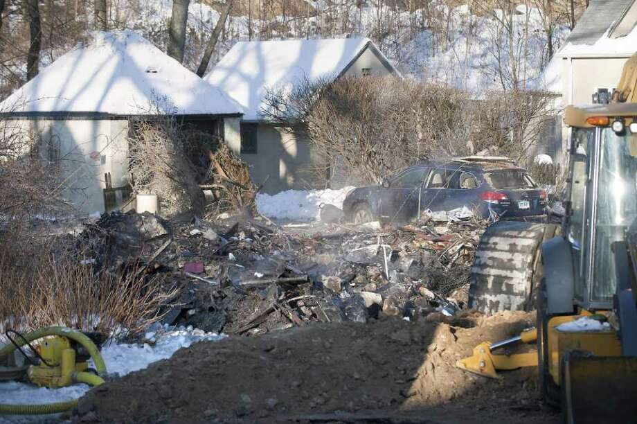 A natural gas explosion blew off the front of James and Andrea Wulffleff home on Ohio Avenue in Norwalk in December 2009. Today, while the final state report on the explosion still isn't finished, regulators are nearly certain the natural gas pipe leading to the Wulffleffs' home exploded because, old and brittle, it had cracked in the chilly temperatures. Photo: Douglas Healey / Stamford Advocate Freelance