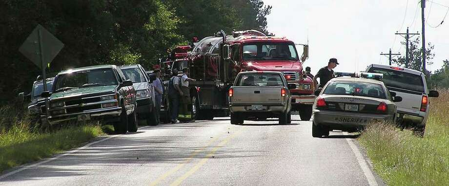 Authorities block a road about a mile from where a propane line exploded Thursday, Nov. 1, 2007, near the Carmichael community in southeast Clarke County, Miss. At least two people were killed and four were injured said officials from the Mississippi Emergency Management Agency. (AP Photo/Clarke County Tribune, Jennifer Bozeman) ** NO SALES MANDATORY CREDIT ** Photo: Jennifer Bozeman / AP2007