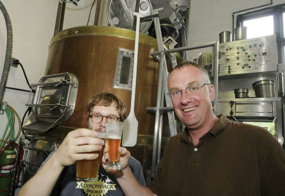 Adirondack Pub and Brewery owner John Carr,right and his head brewer Adam Schmeichel at the brewery in Lake George, NY June 10, 2011.( Michael P. Farrell/Times Union ) Photo: Michael P. Farrell