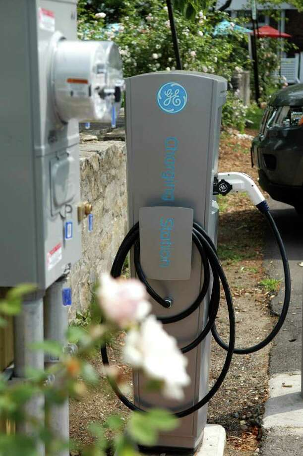 The Sherman Green on the corner of the Post Rd. and Reef Rd. in Fairfield, Conn. has an electric vehicle charger in one of the parking spots. Photo: Cathy Zuraw / Connecticut Post