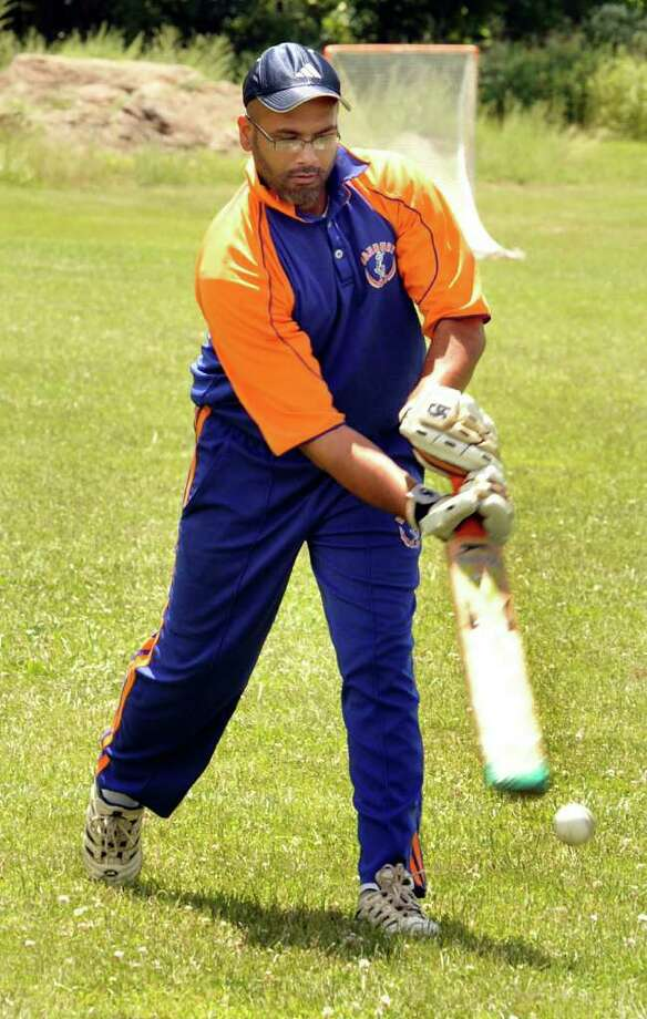 Atif Zafer of the Danbury Cricket Club takes batting practice before the Father's Day match, Sunday, in Danbury, June 19, 2011. Photo: Michael Duffy / The News-Times
