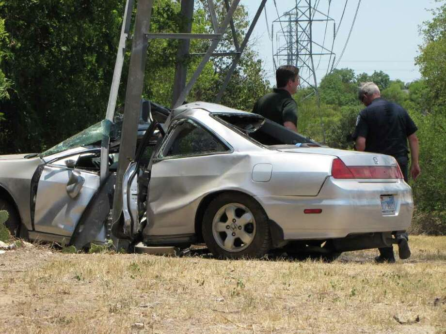 A man was critically injured Sunday afternoon, when he crashed a gray Honda Accord into a high-power line tower on the North Side. Photo: Eva Ruth Moravec/emoravec@express-news.net  / emoravec@express-news.net