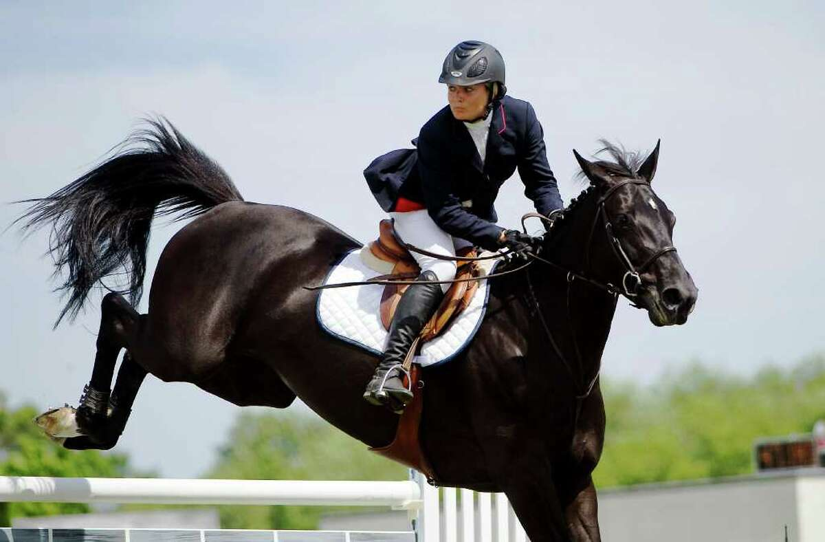 Cassie Herman on South Norwalk competes in the 81st Ox Ridge Charity Horse Show's $30,000 Grand Prix in Darien, Conn., June 18, 2011. 31 riders entered in the class.