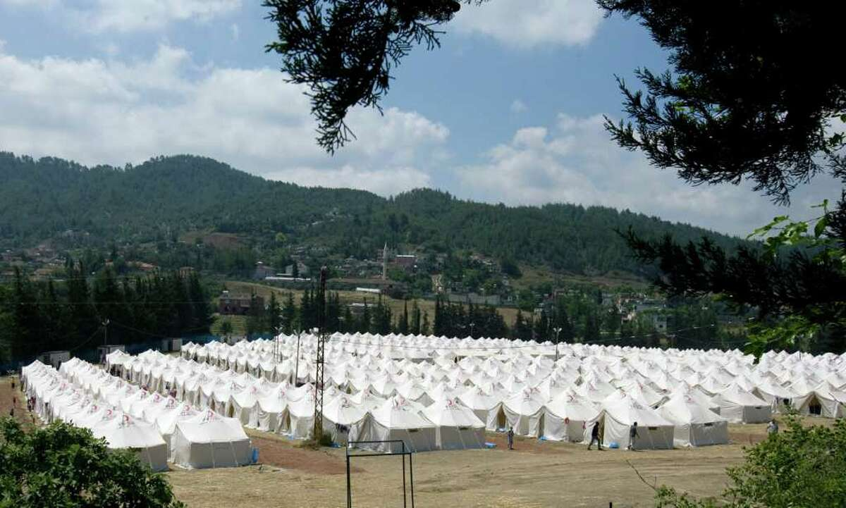 A general view of a newly set up refugee camp for Syrians who fled the violence in their country, the second in the Turkish town of Yayladagi in Hatay province, Turkey, Sunday, June 19, 2011. Turkish authorities say 10,553 refugees were being sheltered in four camps as of Sunday morning as Syrian troops are tightening their grip on villages near the Turkish border, setting up checkpoints and making dozens of arrests according to activists.(AP Photo/Burhan Ozbilici)
