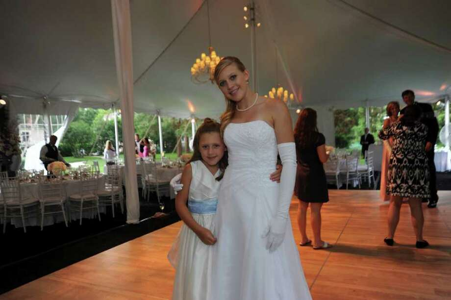 Sumner Hill, 8, with her sister Laurel Meredith Weill at the Greenwich Cotillion 2011 presented by the Junior League of Greenwich, at Tomes-Higgins House on Saturday, June 18, 2011. Photo: Helen Neafsey / Greenwich Time
