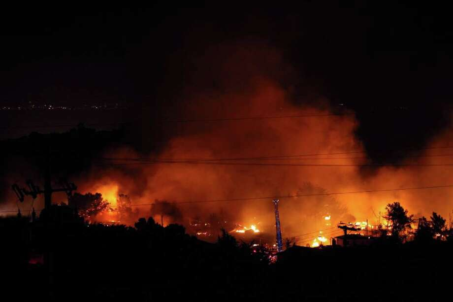 Flames consume homes during a massive fire in a residential neighborhood September 9, 2010 in San Bruno, California. A massive gas line explosion likely rocked a neighborhood near San Francisco International Airport.  (Photo by Ezra Shaw/Getty Images) Photo: Ezra Shaw, Getty Images / 2010 Getty Images