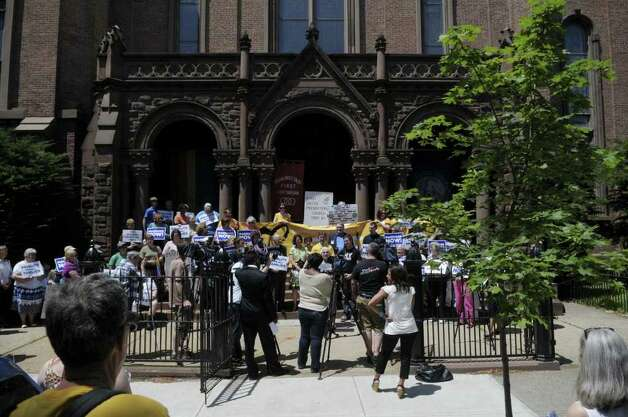 People hold rally in support of gay marriage outside of First United Presbyterian Church on Sunday, June 19, 2011 in Troy.  The rally was held by various area churches and some of their congregation members.  Rallies like this one were held at churches around the state on Sunday.   (Paul Buckowski / Times Union) Photo: Paul Buckowski