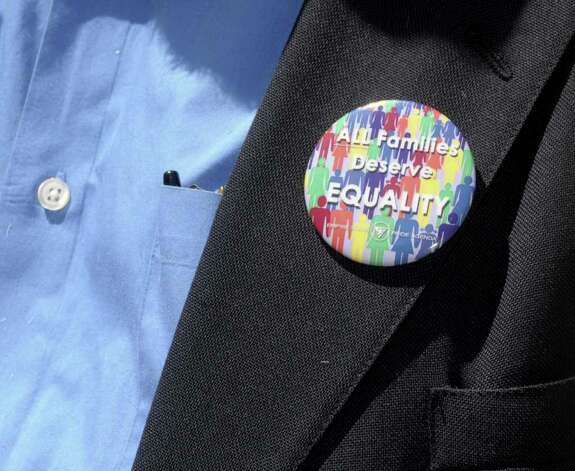 A button is worn by a supporter during a rally in support of gay marriage outside of First United Presbyterian Church on Sunday, June 19, 2011 in Troy.  The rally was held by various area churches and some of their congregation members.  Rallies like this one were held at churches around the state on Sunday.   (Paul Buckowski / Times Union) Photo: Paul Buckowski