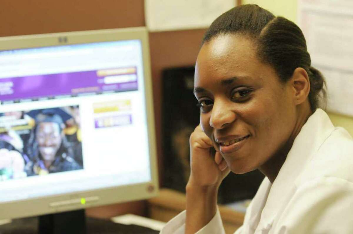 Cynthia McDaniel, a nurse at Albany Medical Center's HIV outpatient clinic, is working on her master's degree in nursing at Excelsior College in Albany.( Michael P. Farrell/Times Union )