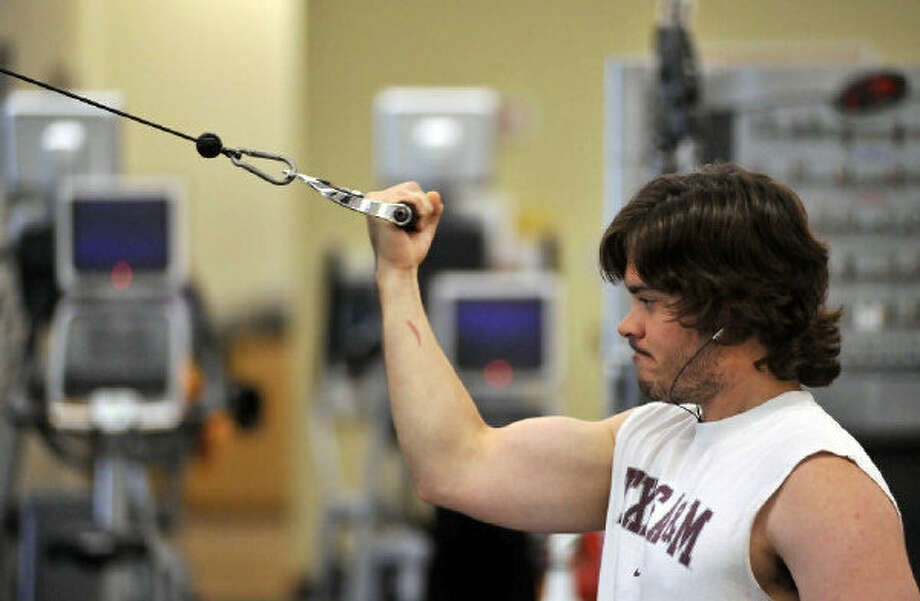 Sean Segovia works out at the TriPoint YMCA, one of the nine locations throughout the city serving some 35,000 members. Photo: Robin Jerstad/Special To The Express-News