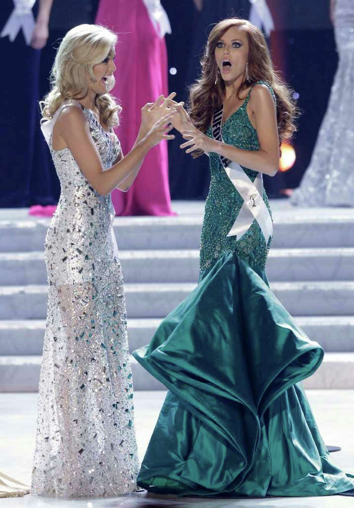 Alyssa Campanella, Miss California, reacts as she is announced as the 2011 Miss USA as Miss Tennessee, Ashley Elizabeth Durham looks on, Sunday, June 19, 2011, in Las Vegas.