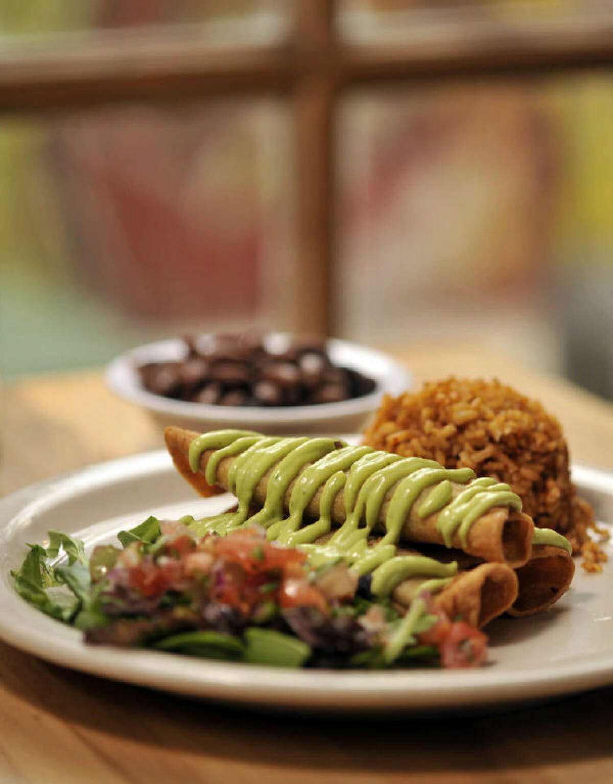 The flauta plate is served with Spanish rice at Green Vegetarian Cuisine.