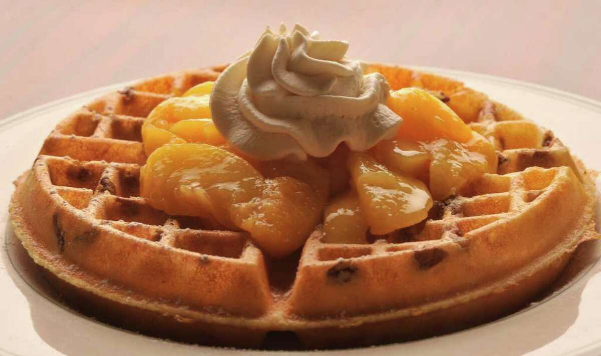 Peach Waffles from the Magnolia Pancake Haus. The restaurant is Readers' Choice for best breakfast and best brunch.