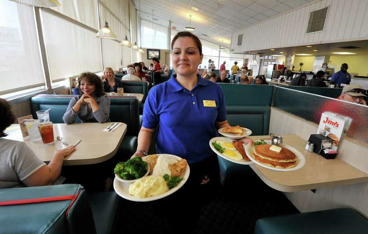 Jo Ann Flores serves breakfast at the original Jim's restaurant on Broadway at Loop 410.