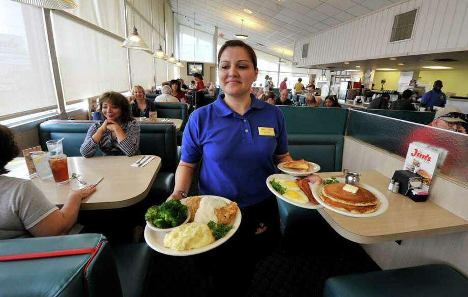 Jo Ann Flores serves breakfast at the original Jim's restaurant on Broadway at Loop 410. Photo: Robin Jerstad/Special To The Express-News