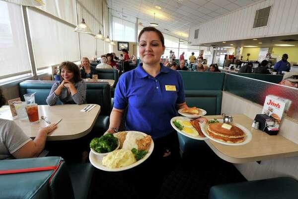 Jo Ann Flores serves breakfast at the original Jim's restaurant on Broadway at Loop 410.