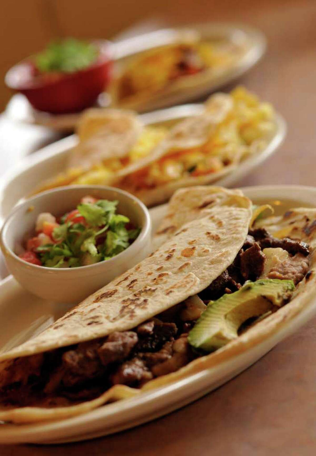 Taco Taco Café lists 21 varieties of tacos, but owner Helen Velesiotis can count at least 300 possible combinations.
