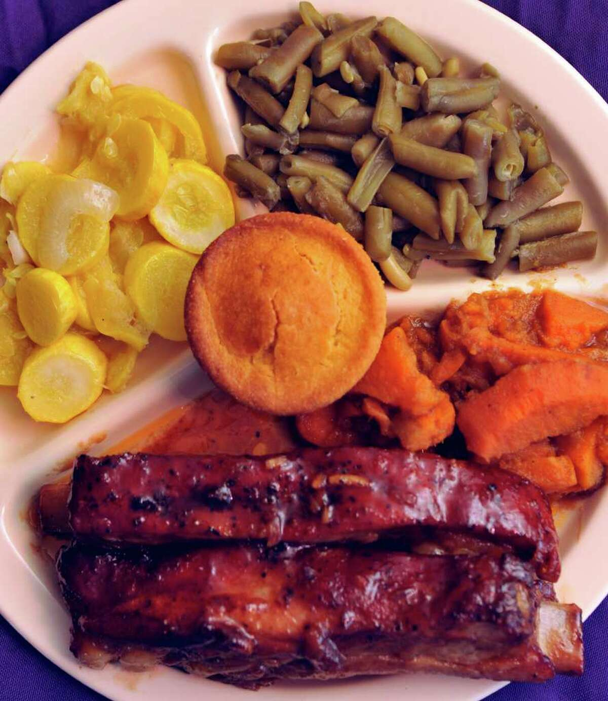 Barbecued ribs with sweet potatoes, green beans, squash and corn bread is one of many combinations from the line at Mr. & Ms. G's Home Cooking.
