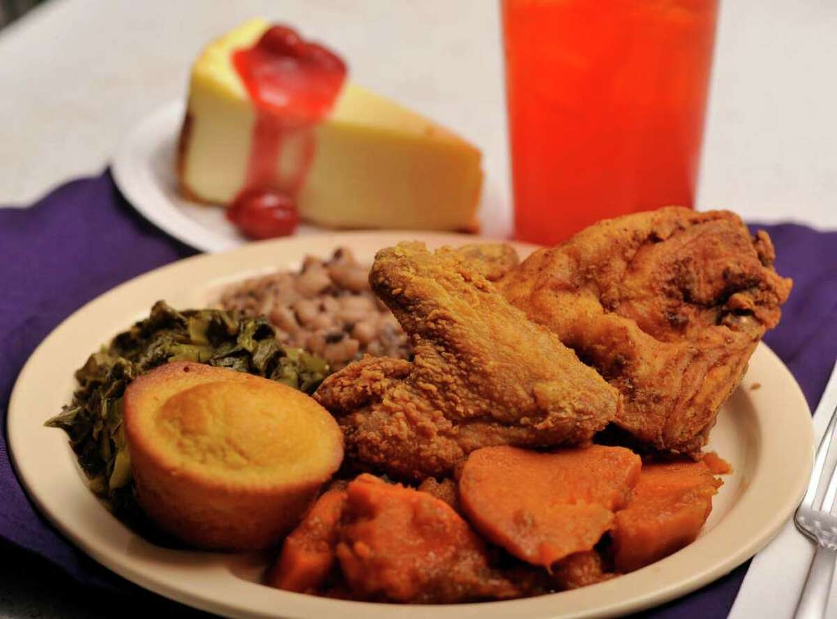 Fried chicken - a favorite with customers - is accompanied by sweet potatoes, black-eyed peas, greens and corn bread, all prepared Southern style.