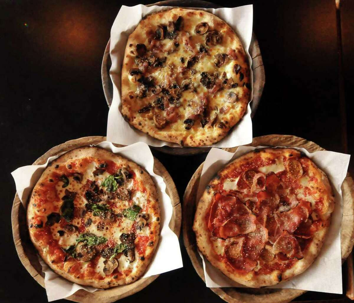 Dough Pizzeria Napoletana varieties include Margherita with mushrooms (clockwise from top), Pork Love and fontina.