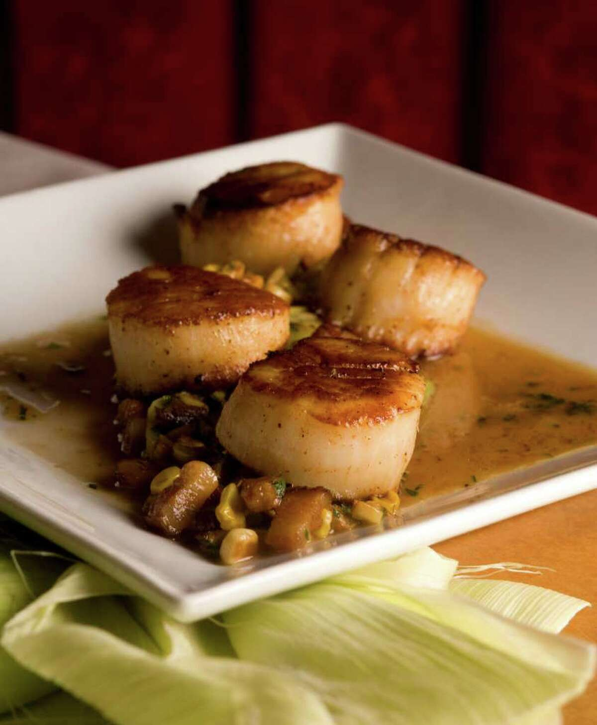 Seared scallops is one of the menu items at Coco Chocolate Lounge & Bistro.