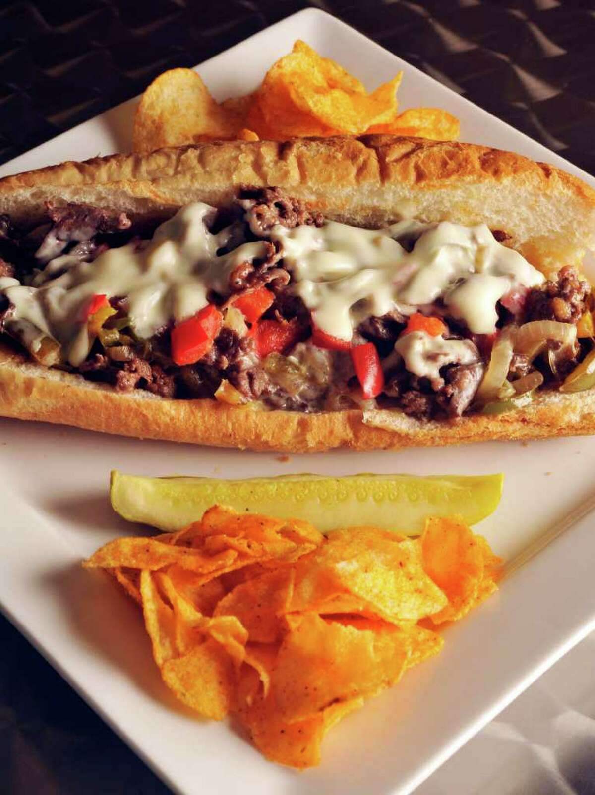 A Philly Steak sandwich with chips from the Spice Rack Deli.