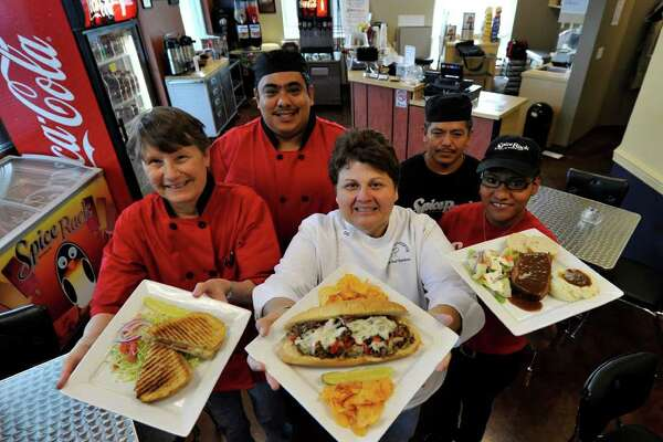 Nan Frechette (front row, from left), co-owner/chef Connie Santos, Carol Esquivel, Gilbert Ortiz Jr. (back left) and Fernando Lozada Ramirez  are back in the Medical Center area.