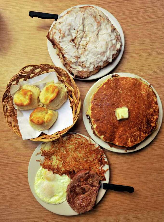 Steak and eggs, pancakes, biscuits and giant cinnamon rolls gave Mr. Tim's the best breakfast nod from critics. Photo: Robin Jerstad/Special To The Express-News