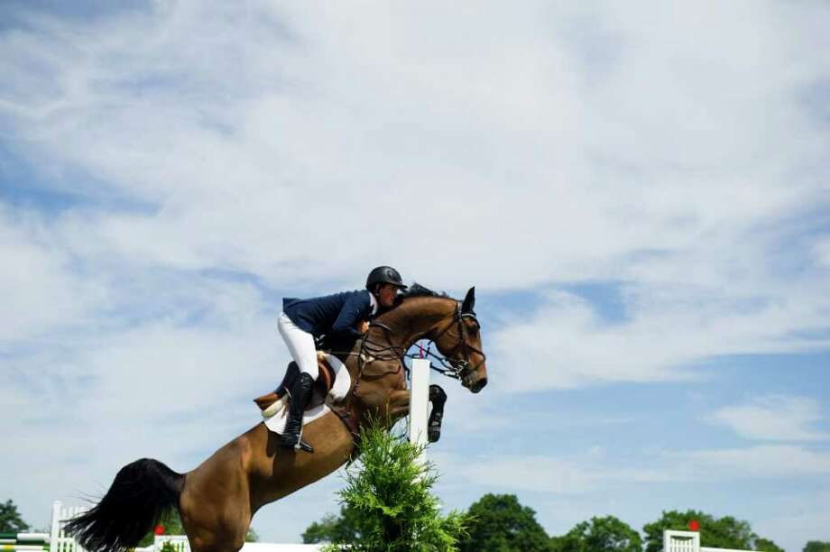 Nick Dello Joio and Ragna T soar to victory in the 81st Ox Ridge Charity Horse Show's $30,000 Grand Prix in Darien, Conn., June 18, 2011.  31 riders competed in the class. Photo: Keelin Daly / Stamford Advocate